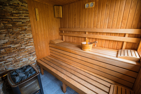 Empty sauna room with traditional sauna accessories Stock Photo