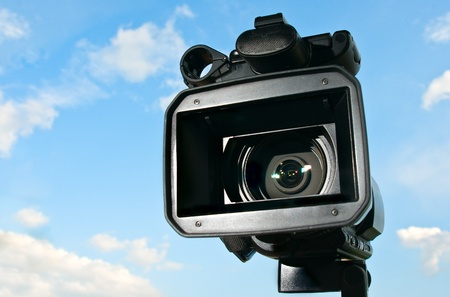 Professional Video Camera with sky in the background