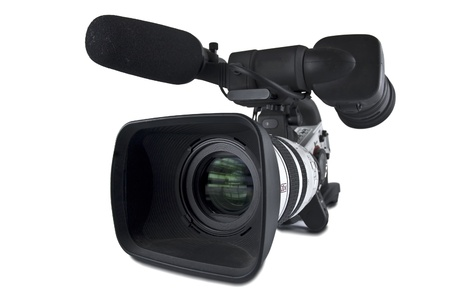 Professional video camera pointing to camera left.Focus is on the front With Clipping Path