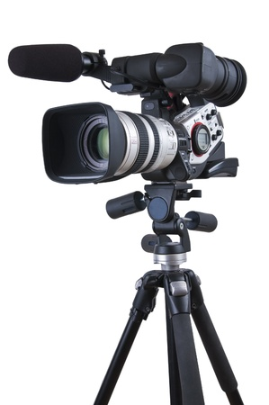 Professional video camera set on a tripod (with excellent clipping path) Stock Photo