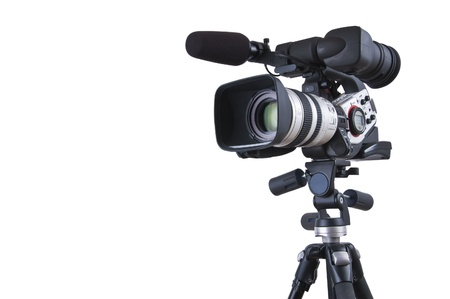 Professional video camera set on a tripod with copy space (with excellent clipping path) Stock Photo