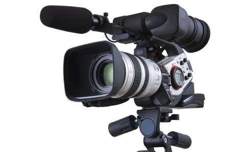 Closer look of Professional Video camera set on a tripod (with excellent clipping path) Stock Photo