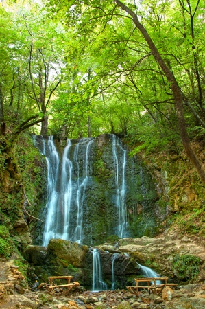 A gorgeous waterfall nestled in an Mountain Belasica (Macedonia) with the sun's rays illuminated by the mist.