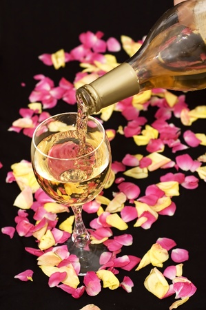 White wine pouring down from a bottle. Good for romantic designs. photo