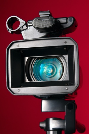 Professional video camera on a red background Stock Photo - 10297443