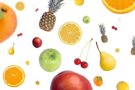 Variety of falling fresh fruits on white background Stock Photo