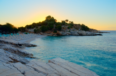 Small beach located in the bay at sunset Stock Photo