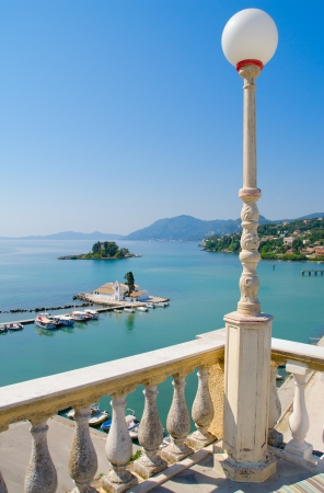Beautiful balcony view of Vlacherna monastery in Corfu, Greece.