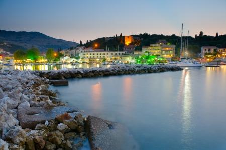 Sunset over Kassiopi Port, Corfu, Greece photo