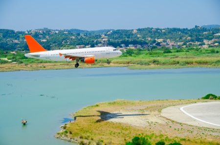 Airplane almost at touch down, at Kerkyra airport Stock Photo
