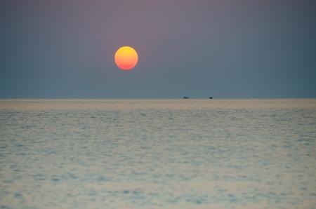 Sunrise over fishermen boats on the sea