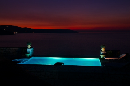Amazing Twilight sunset and pool by the sea
