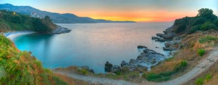 Idyllic sunset over the sea bay Standard-Bild