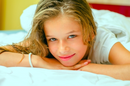 young beautiful girl relaxing in bed Stock Photo