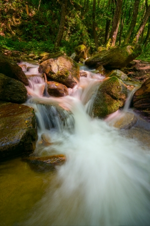 Wild waters flowing over red rocks