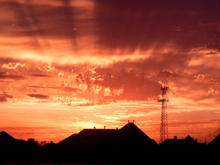 Sunset after storm with houses photo