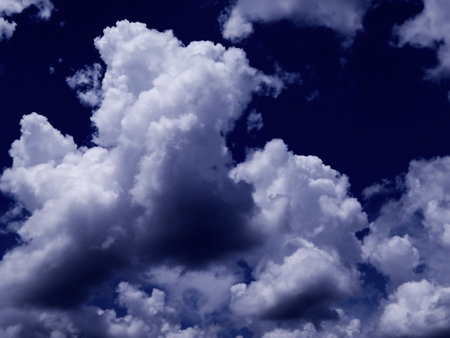 midday: Fluffy clouds in midday blue sky