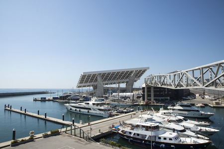 Barcelona, Spain - April 9, 2014  Marina with luxury yachts and restaurants called Port Fòrum with huge solar power plant to the bottom port Marina with luxury yachts and restaurants called Port Fòrum with huge solar power plant to the bottom port