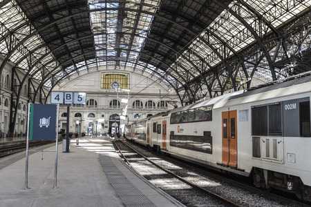 Barcelona, Spain  April 9, 2014  Panoramic of train waiting for departure in Estacio de França in Barcelona with people in the background   France Station  is a historic railway station in the city of BarcelonaTrain waiting for departure the Estacio de F