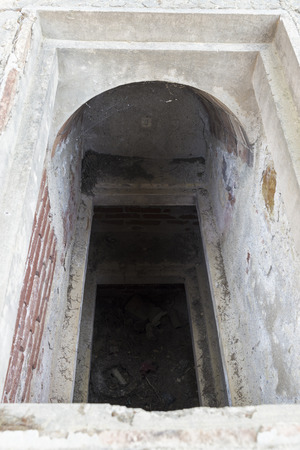 tomb empty: Open and empty tomb in a cemetery  The tomb is at ground level and has three levels  Stock Photo
