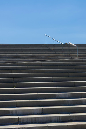 Stairway out of concrete in bright sunshine photo