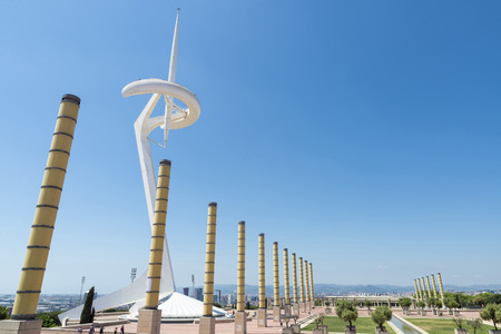 Barcelona, Spain - May 9, 2014  Telecommunications tower and Palau Sant Jordi of the olympic village in Barcelona, Catalonia, Spain  The tower is owned by Telefonica