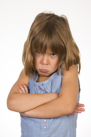 Little girl about to mourn with arms crossed photo