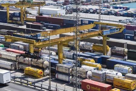 vats: Barcelona, Spain - May 14, 2014: Overview of Container Terminal in the port of Barcelona where there are all kinds of containers, vats and new cars for export Container Terminal in the port of Barcelona