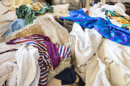 A heap of clothes for sale in the most famous flea market in Barcelona, also known as Els Encants or Els Encants Vells, located in Glories neighborhood   Stock Photo