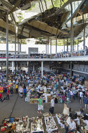 els: Barcelona, Spain - June 18, 2014  Overview of the most famous flea market in Barcelona, also known as Els Encants or Els Encants Vells, located in Glories neighborhood  It shows customers, vendors their jobs and their reflection in the ceiling mirror show Editorial