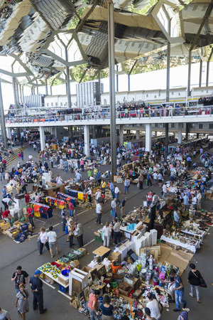Barcelona, Spain - June 18, 2014  Overview of the most famous flea market in Barcelona, also known as Els Encants or Els Encants Vells, located in Glories neighborhood  It shows customers, vendors their jobs and their reflection in the ceiling mirror show Editorial