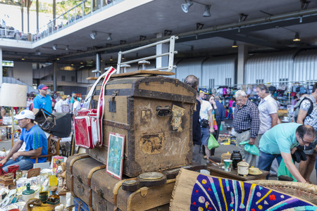 resale: Barcelona, Spain - June 18, 2014  Several sellers at their posts of objects, antiques, and furniture resale while many clients are looking for something to buy in the most famous flea market in Barcelona, also known as Els Encants or Els Encants Vells, lo Editorial