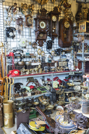 resale: Barcelona, Spain - June 18, 2014  Objects used, furniture, artwork and ornaments on a market stall in the most famous flea market in Barcelona, also known as Els Encants or Els Encants Vells, located in Glories neighborhood Objects used, furniture, artwor Editorial