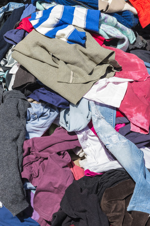 A heap of clothes for sale in the most famous flea market in Lisbon, also known as the Feira da Ladra or Thieve photo