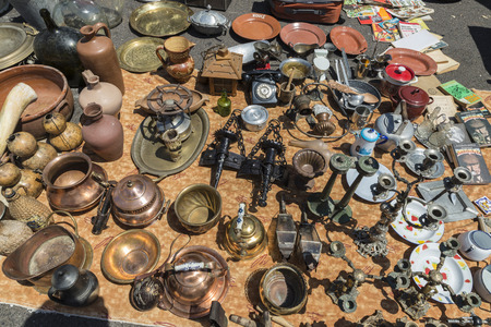 Lisbon, Portugal - August 19, 2014:  Objects used, furniture, artwork and ornaments on a market stall in the most famous flea market in Lisbon, also known as Feira Da Ladra, located in the district of Alfama.Objects used, furniture, artwork and ornaments