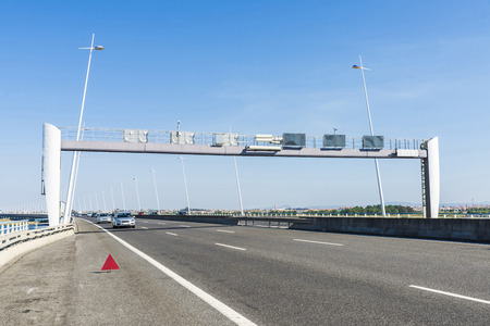Information panel and speed control on a highway bridge in Lisbon, Portugal photo
