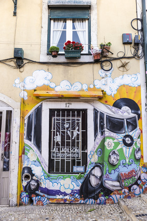 Lisbon, Portugal - August 17, 2014: record store in the old quarter of Lisbon, named Alfama district. The storefront is decorated with graffiti of a Volkswagen van
