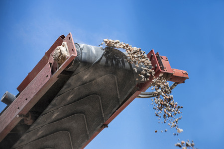 closeup conveyor belt carrying gravel photo