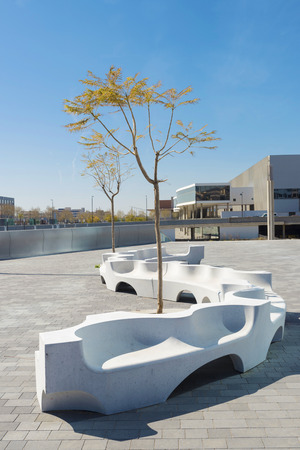 Modern urban park with benches in Barcelona, Catalonia, Spain photo