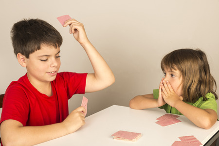 kids playing cards at home