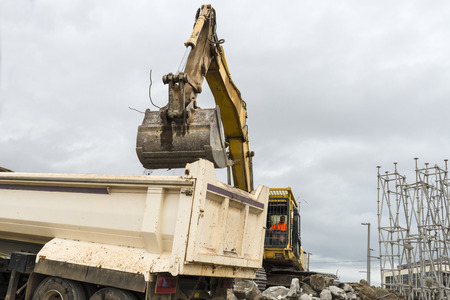 Barcelona, Spain - 12 May, 2014: excavator placing sand or debris on a truck
