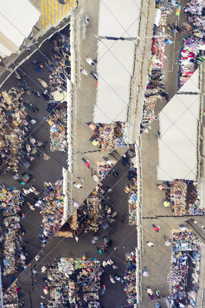 els: Barcelona, Spain - May 12, 2014: Unidentified people and market stalls reflected on a mirror ceiling of the most famous flea market in Barcelona, also known as Els Encants or Els Encants Vells, located in Glories neighborhood.  Unidentified people and mar Editorial