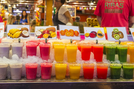 Barcelona, Spain - October 17, 2014: Fruit stand with smoothies ready to take on the market of La Boqueria in Barcelona, ​​Catalonia, Spain