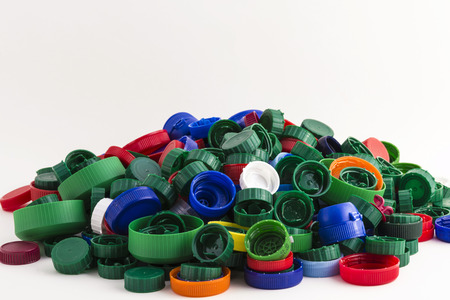 lots of plastic caps isolated on white background