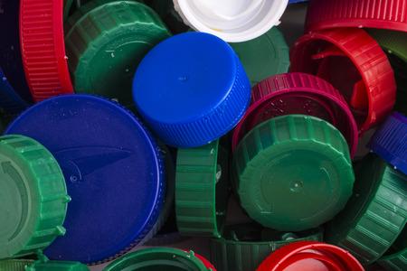 Closeup of a pile of plastic caps photo