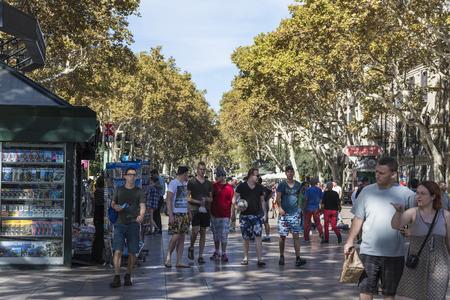 the ramblas: Barcelona, Spain - October 17, 2014:  People walking on Las Ramblas, the most popular street in Barcelona. Editorial