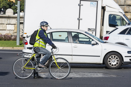 stopped: Barcelona, Spain - November 7, 2014: Stopped bicycle between traffic on a street in Barcelona