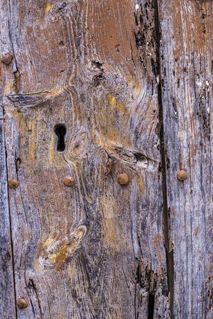 old wooden door with lock photo