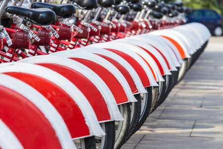 A row of rental bikes in their docking stands in downtown Barcelona, Catalonia, Spain photo
