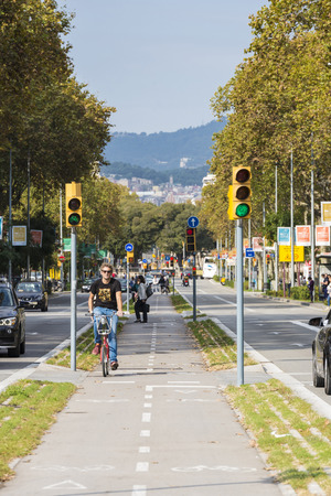 Barcelona, Spain - October 29, 2014: cyclist circulating for a bike path in central Barcelona Editorial